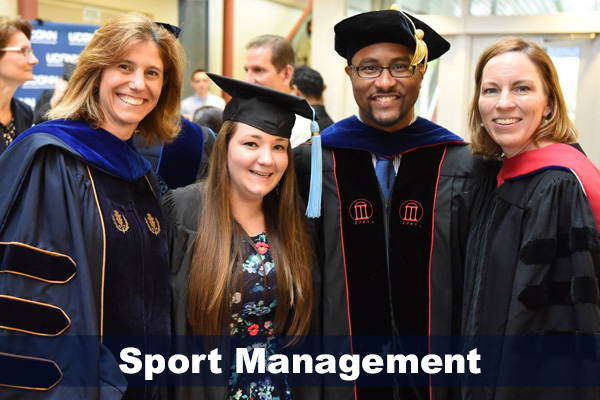 Drs. Laura Burton, Joseph Cooper and Jennie McGarry with female graduate, 2016